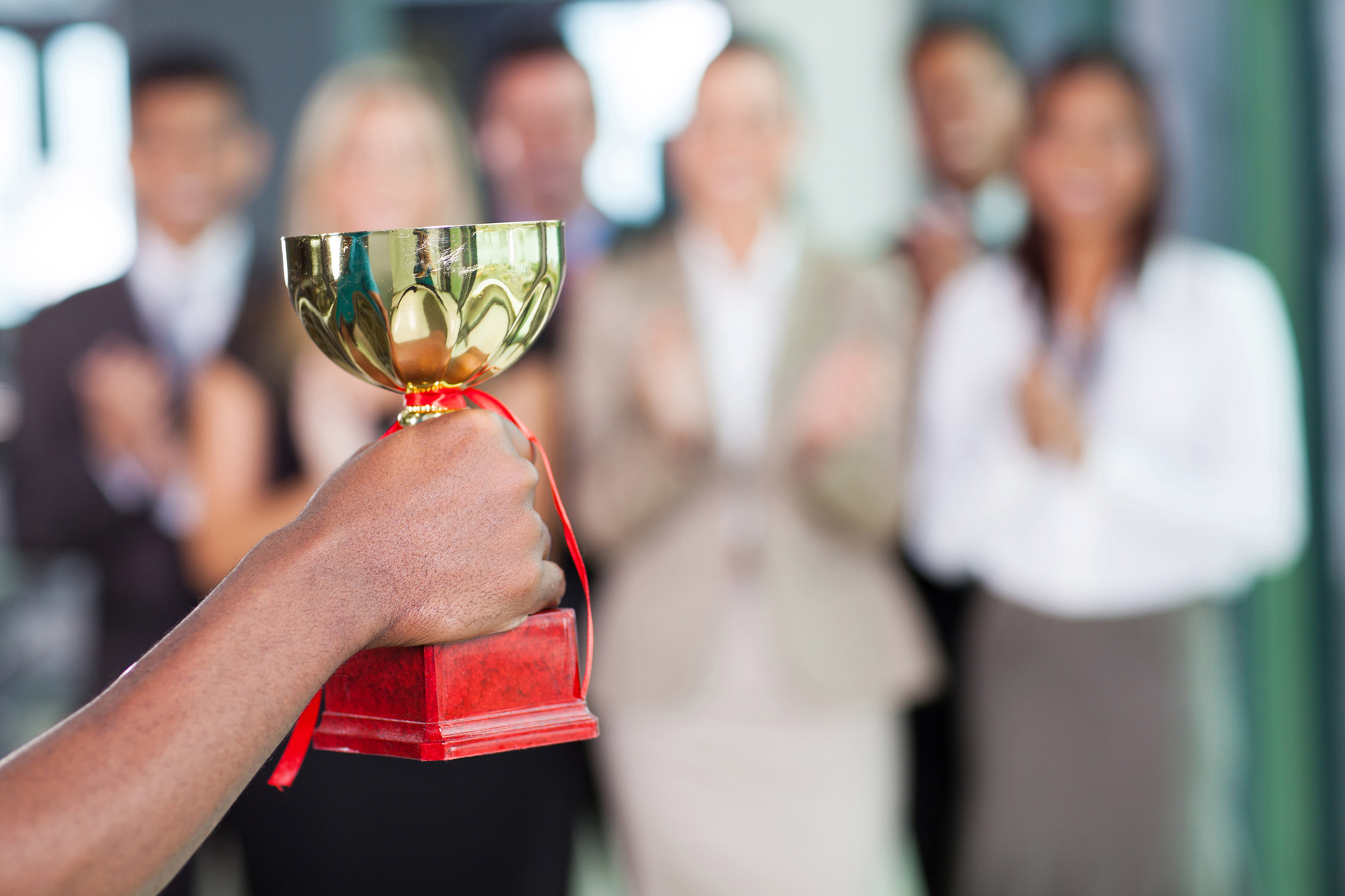 business team winning a trophy