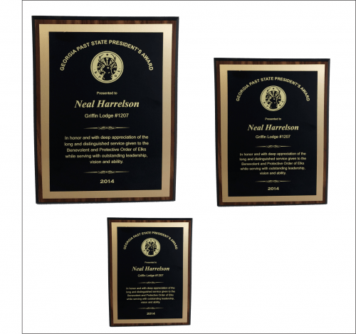 Walnut finish plaque w/ Brass Plate & Gold Backplate